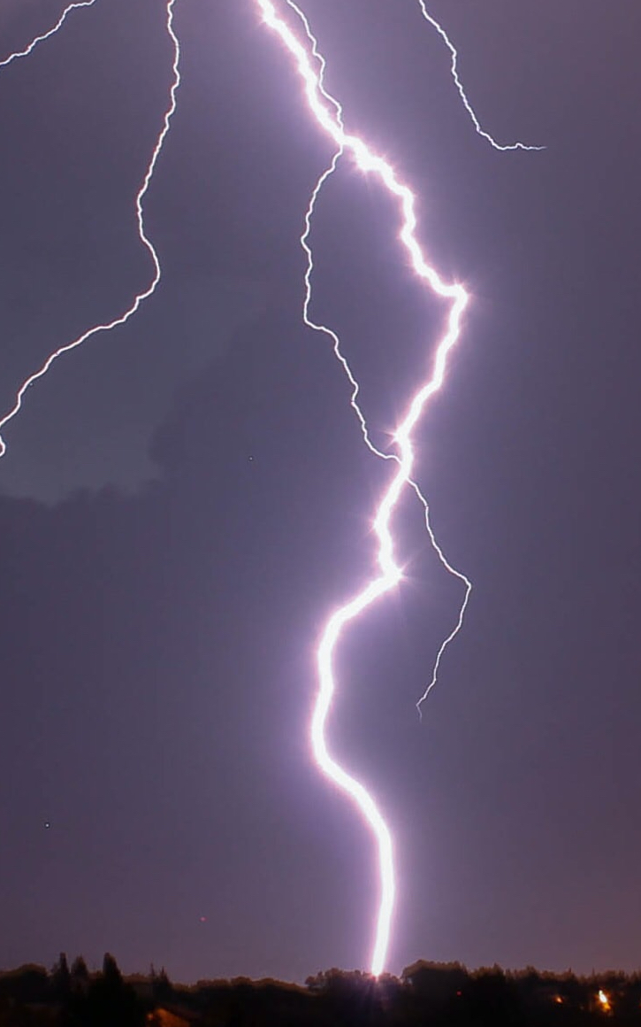 lightning against a purple sky