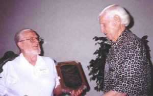 At a meeting of the American Scientific Affiliation in 1997, biochemist Walter Hearn (left) presents a plaque to the first president of the ASA, the late F. Alton Everest, a pioneering acoustical engineer from Oregon State University.