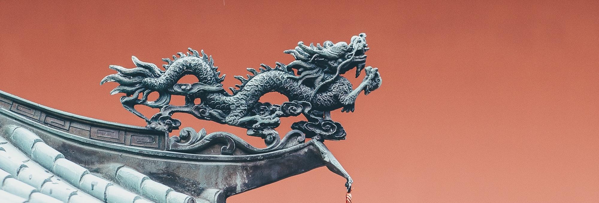 stone dragon atop a pagoda