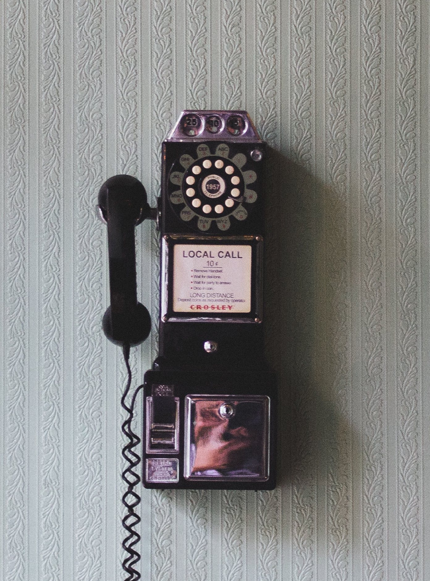rotary phone on a wall