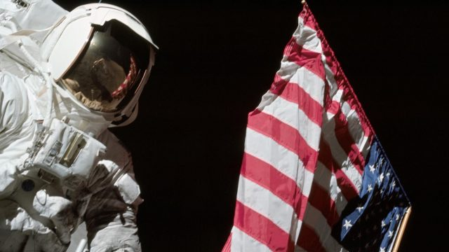 american flag with an astronaut