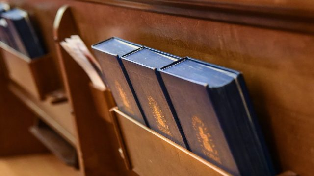 Church pew with bibles