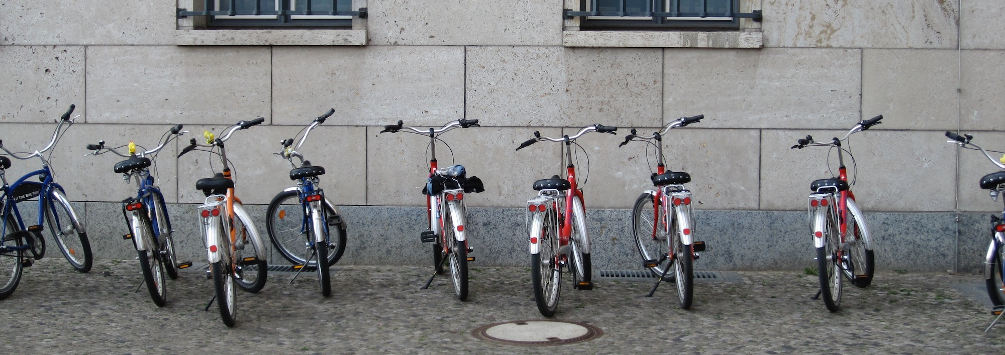 bikes in a row against a building