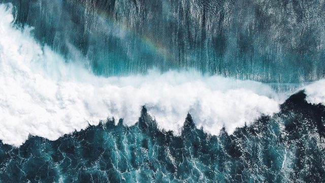 aerial view of breaking ocean wave