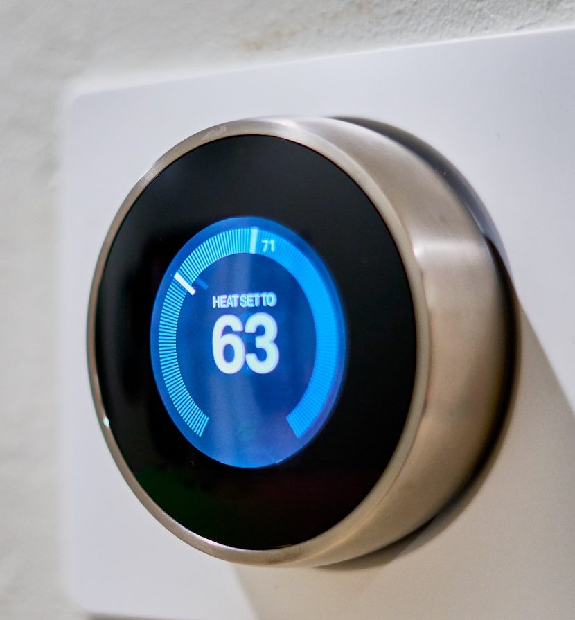 programmable thermostat set to 63 degrees