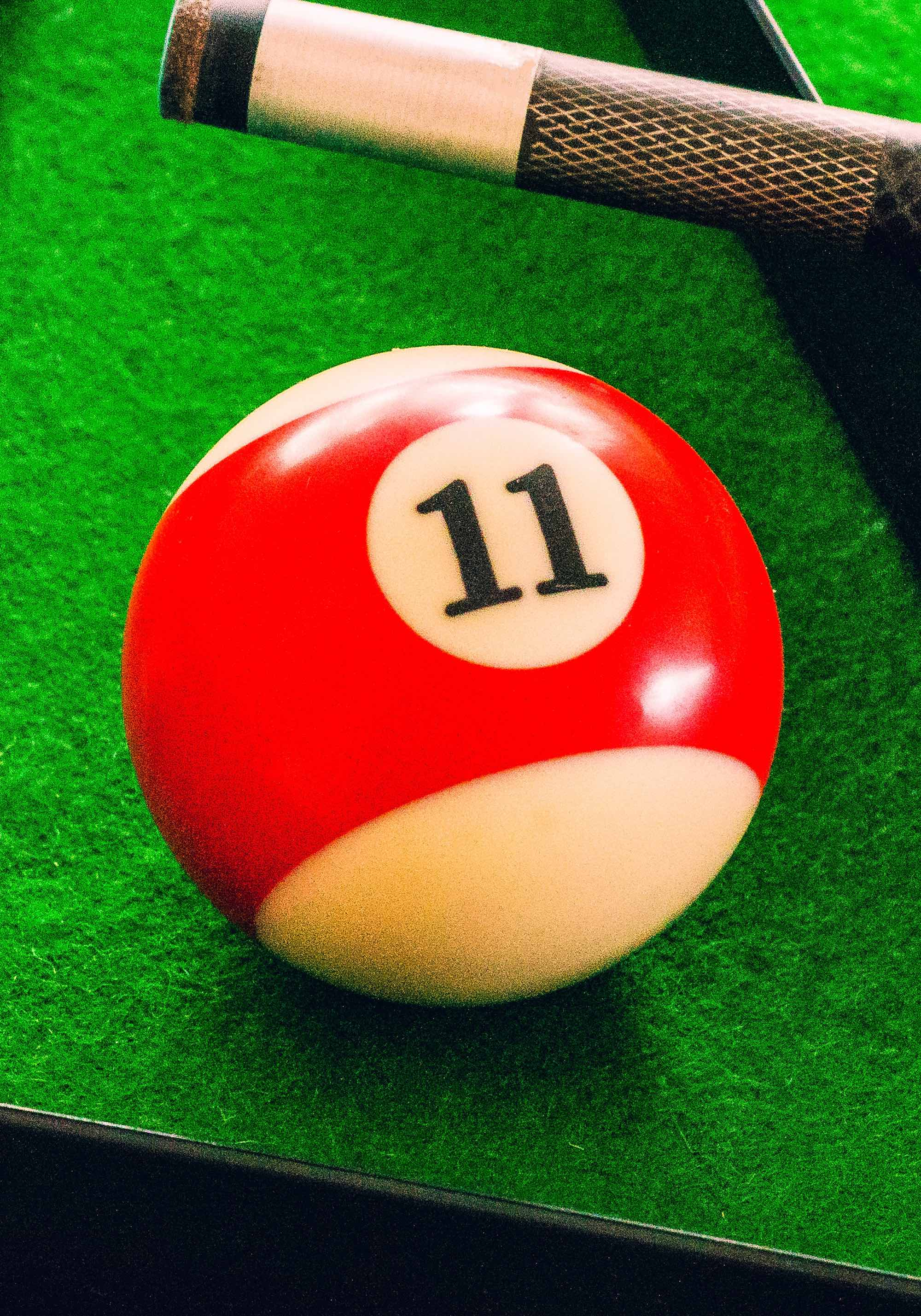 red striped billiard ball with the number 11
