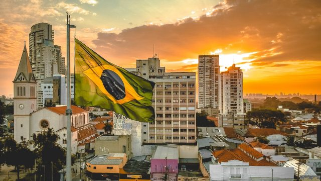 skyline of Brazil with the Brazilian Flag in the foreground