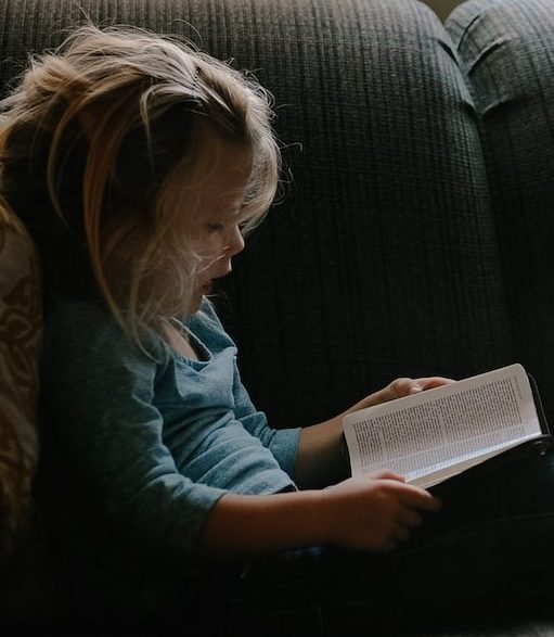 little girl reading bible