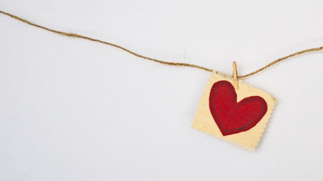 fabric heart fastened to a rope with a clothes pin