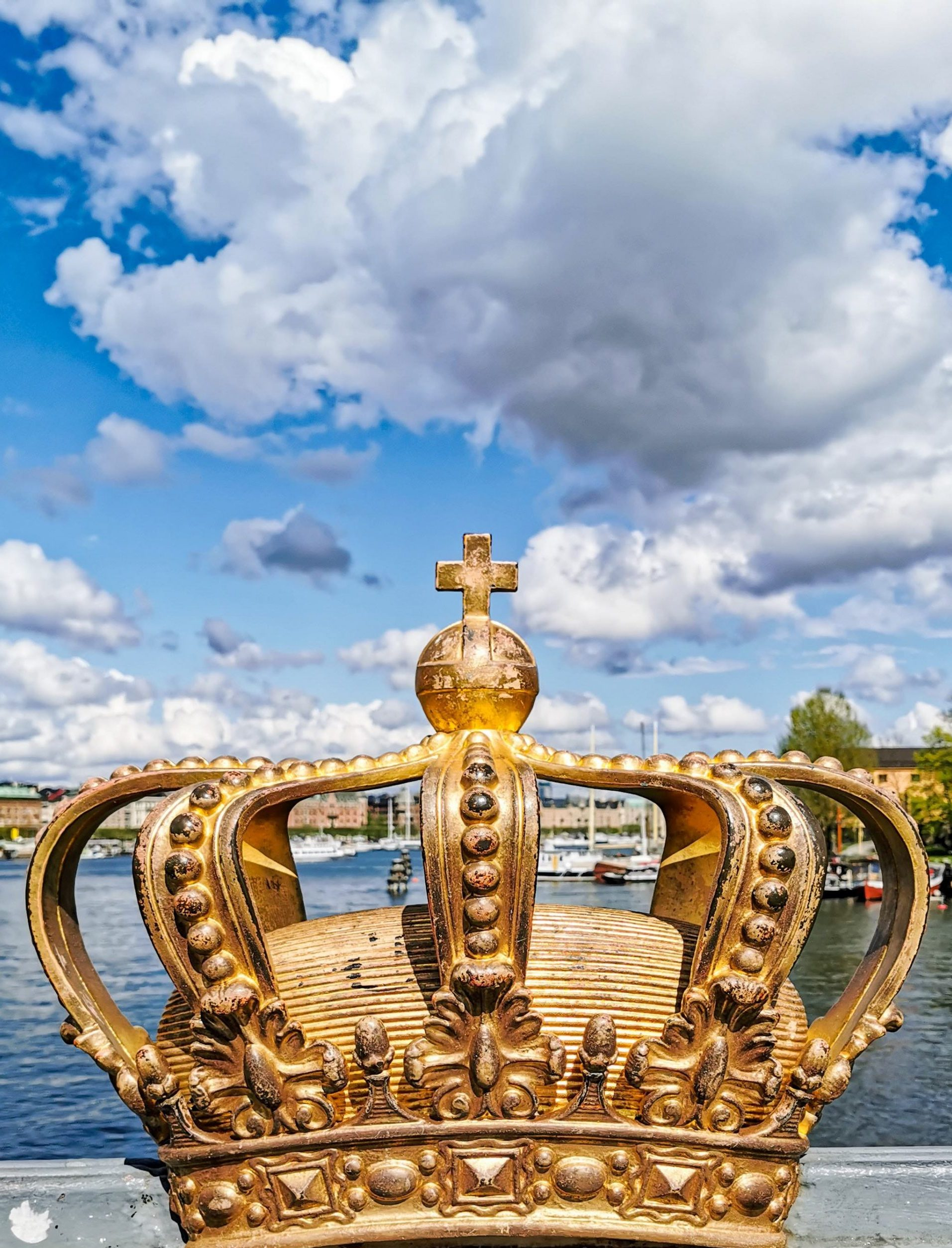 gold crown against a blue sky