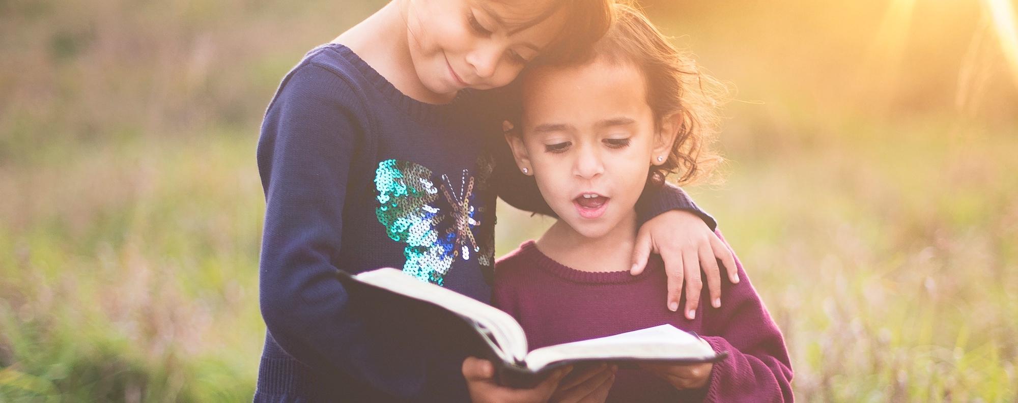 girls reading bible