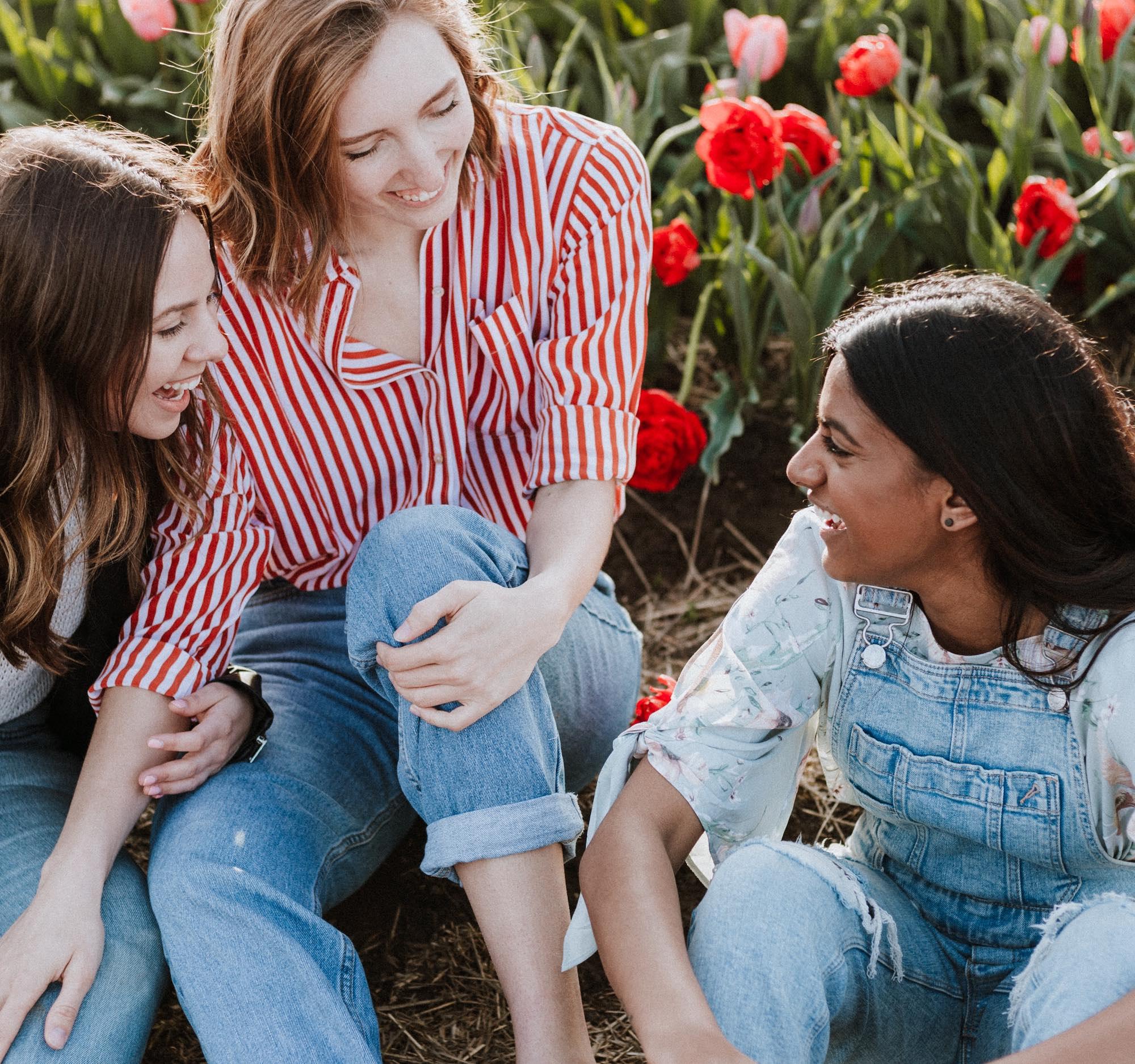girls talking sitting on the ground