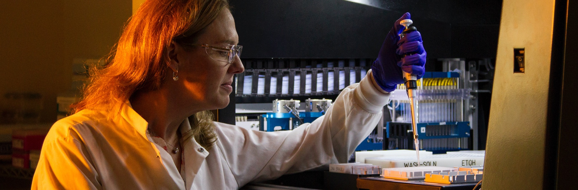 woman pipetting in a lab