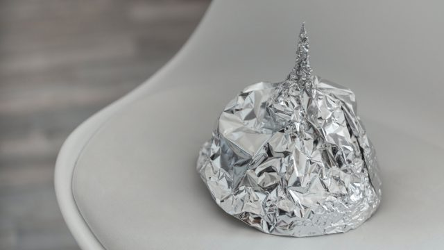 tin foil hat sitting on a chair