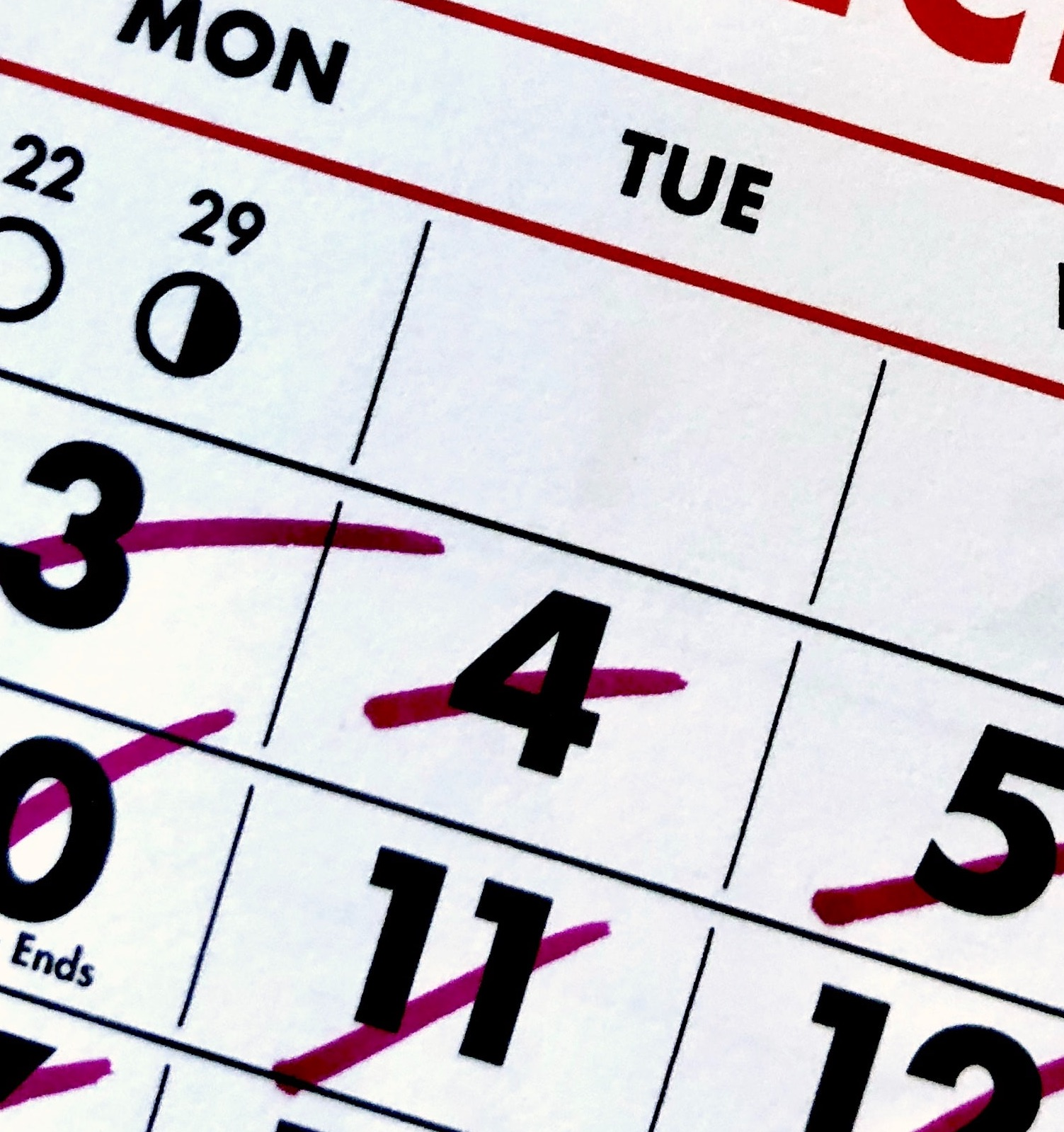 a close up of a calendar with days crossed off