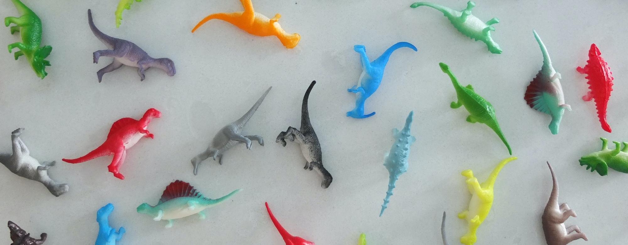dinosaur toys scattered around