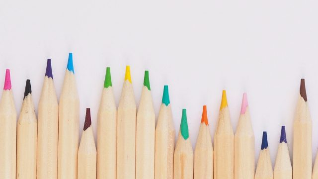 colored pencils sharpened in a line