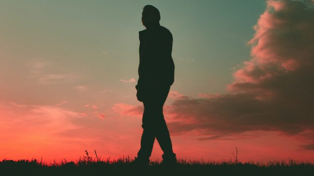 silhouette of person in front of sunset