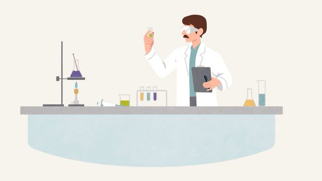 Animated Francis Collins at lab table