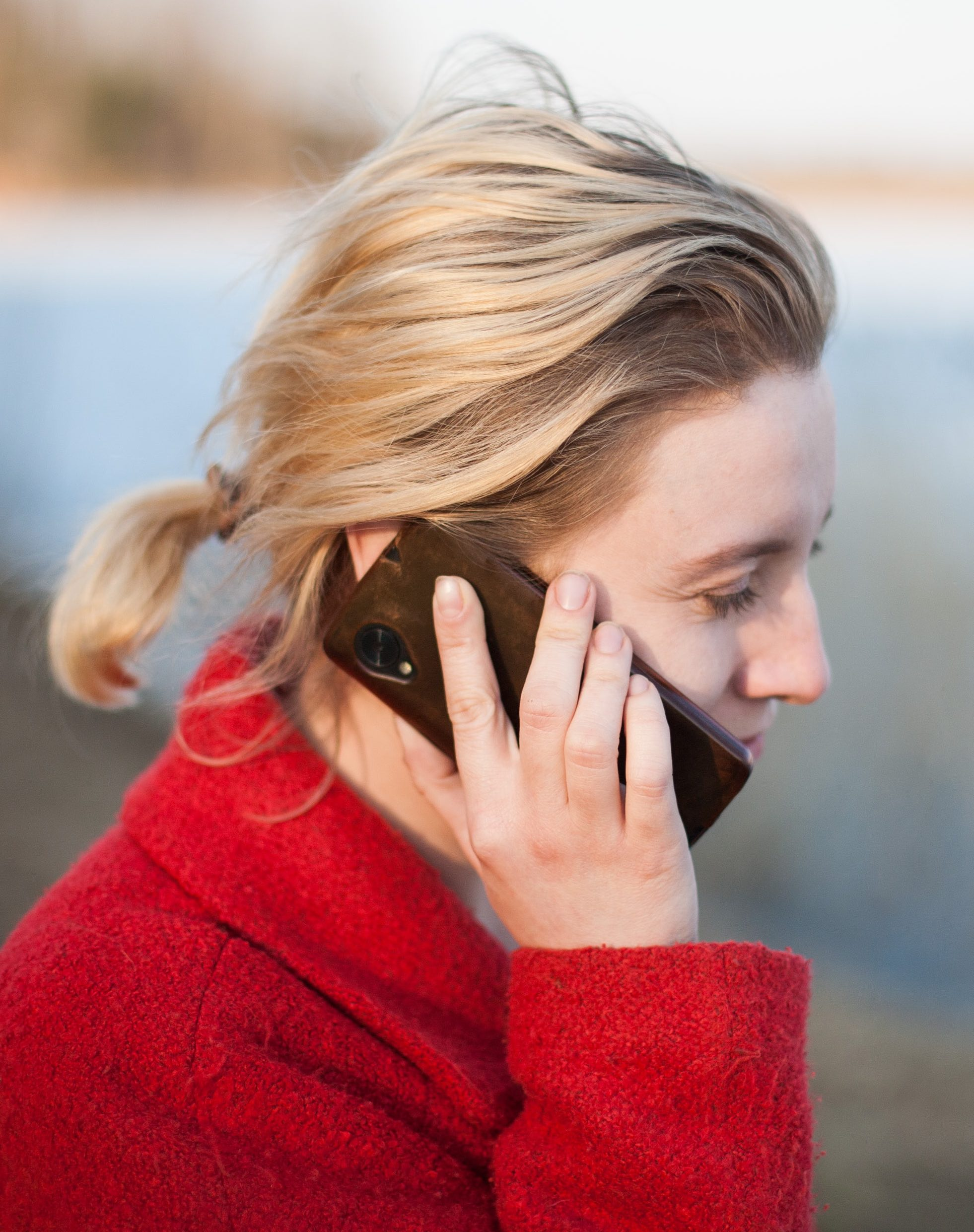 woman in ponytail talking on a phone