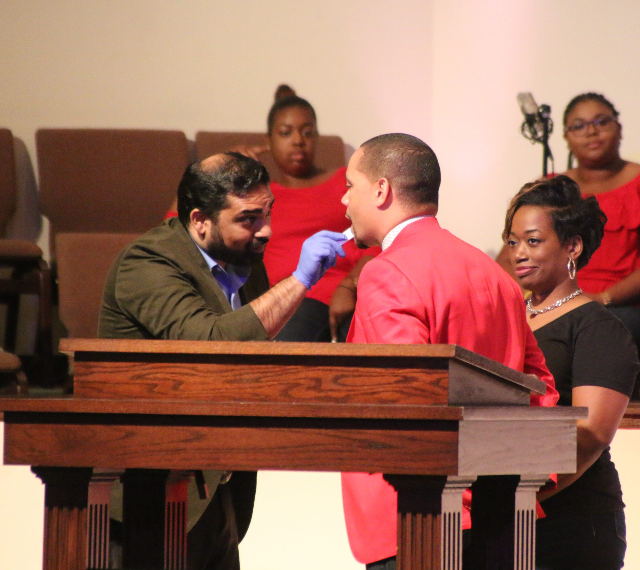Pastor Faison getting HIV tested at church