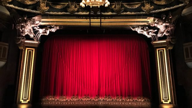 a theatre stage with a red curtain