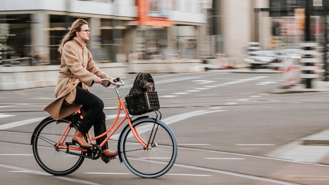 woman riding a bike in the street