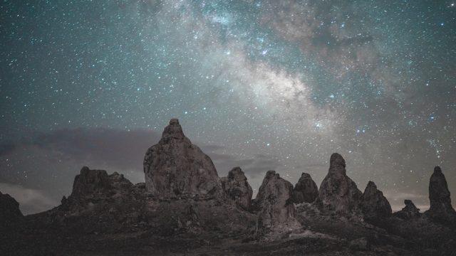 photo of milky way above rocks in the Mojave desert