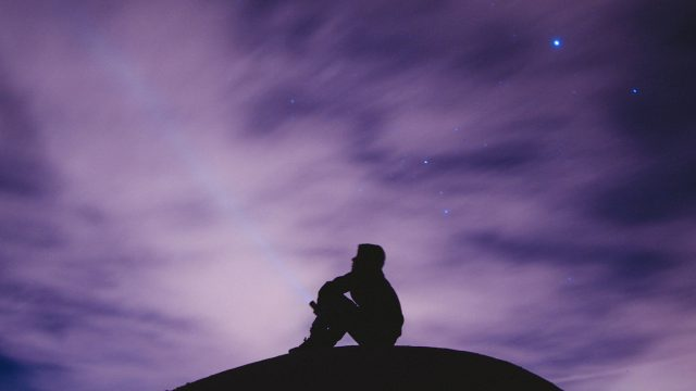 silhouette of person looking at sky